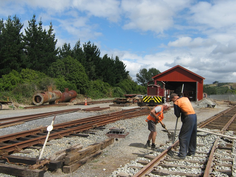 John and Hugh tamping ballast on turntable road, Tr189 in background