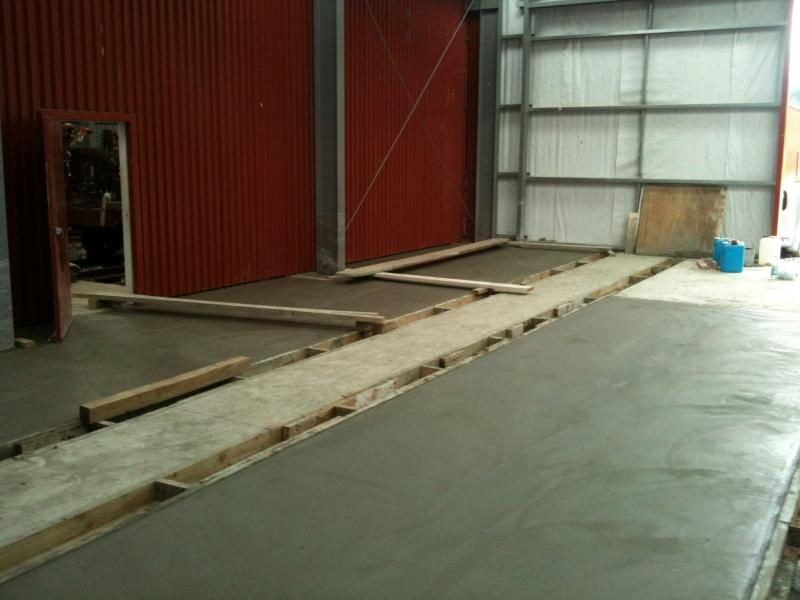 The workshop transformed with the completion of concrete floors.