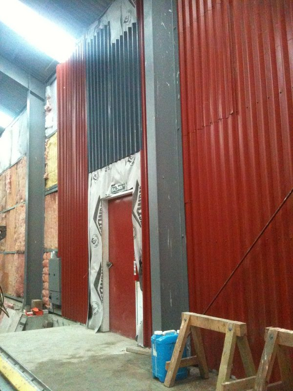A start was made on cladding the internal wall between workshop and main shed in January 2016.