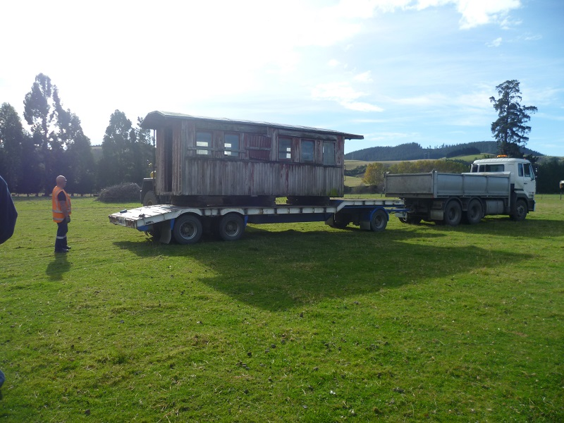 Half of carriage A255 being recovered from a farm on the Taieri Plains, Dunedin.