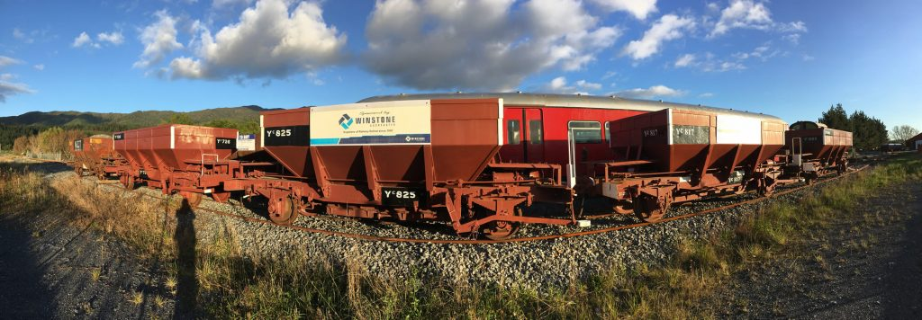 Panorama shot of rake of ballast wagons parked at Maymorn station