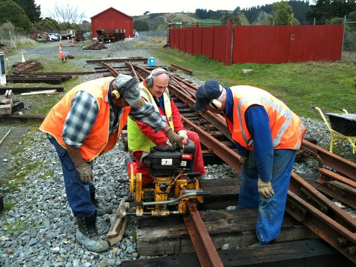 Colin, Peter and John drilling heel bolt holes in outer slip rail