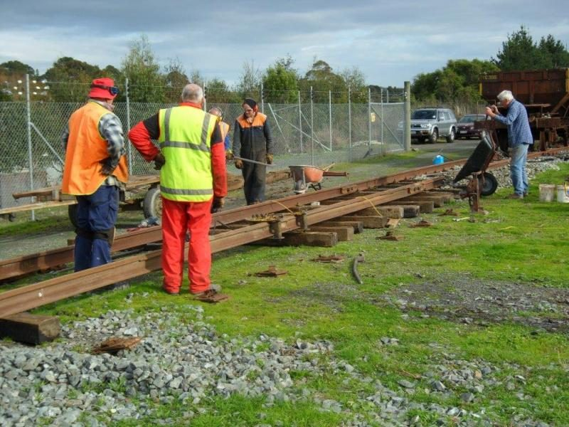 Colin and Peter straightening 50kg rail, whilst Hugh and John position sleepers, Lionel adding ballast to first set.