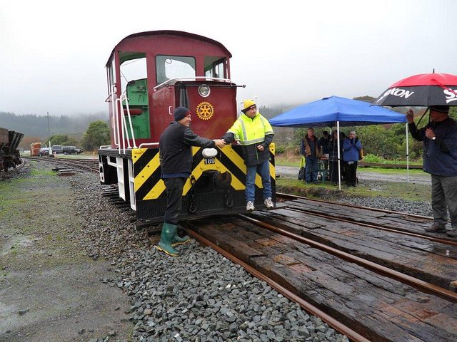 Kevin Joyce, right, and Hugh McCracken, left, celebrate unveiling of Rotary International badge affixed to shunting locomotive Tr 189. Photo: Glenn Fitzgerald.