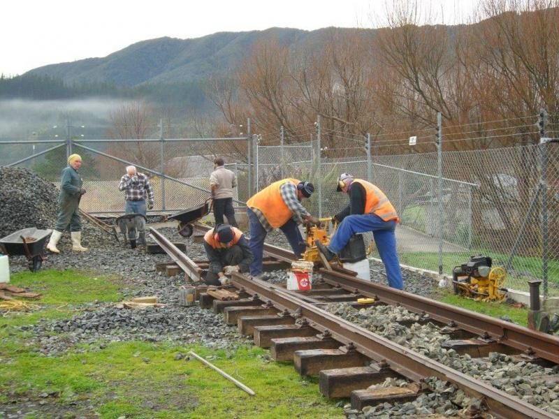 Cutting and drilling rail near the crossing on 29 June. Photo:Glenn Fitzgerald.