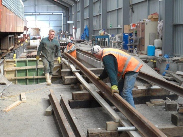 John, Bruce and Colin positioning rails onto road 1 pit