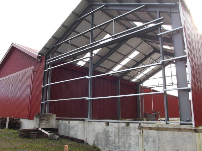 workshop structure with all roof installed and south wall clad