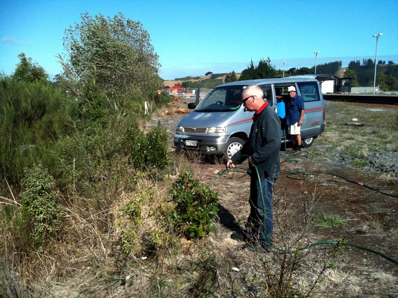 Bart and Graeme watering native shrubs planted at Maymorn