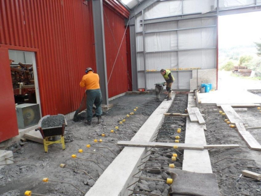 Colin and Hugh backfilling workshop floor