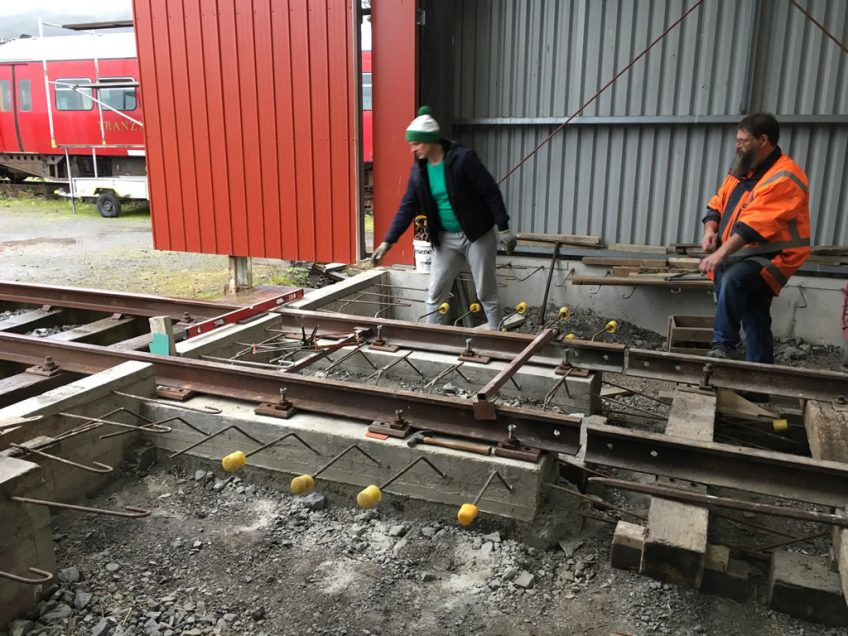 Ray and Glen back filling around rail beams on road 2