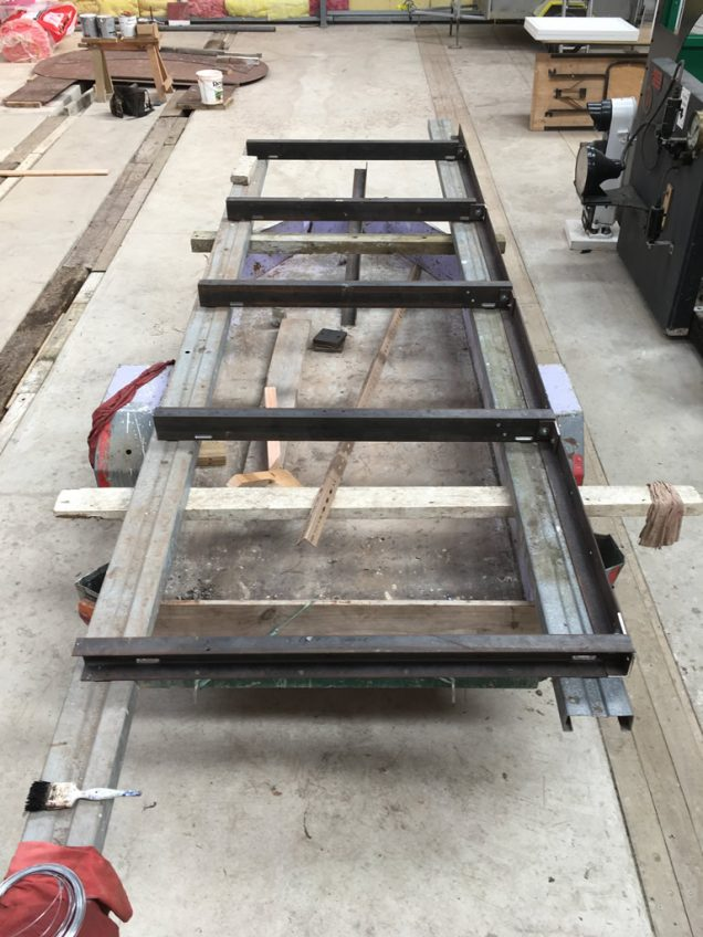 Frame members laid out for welding