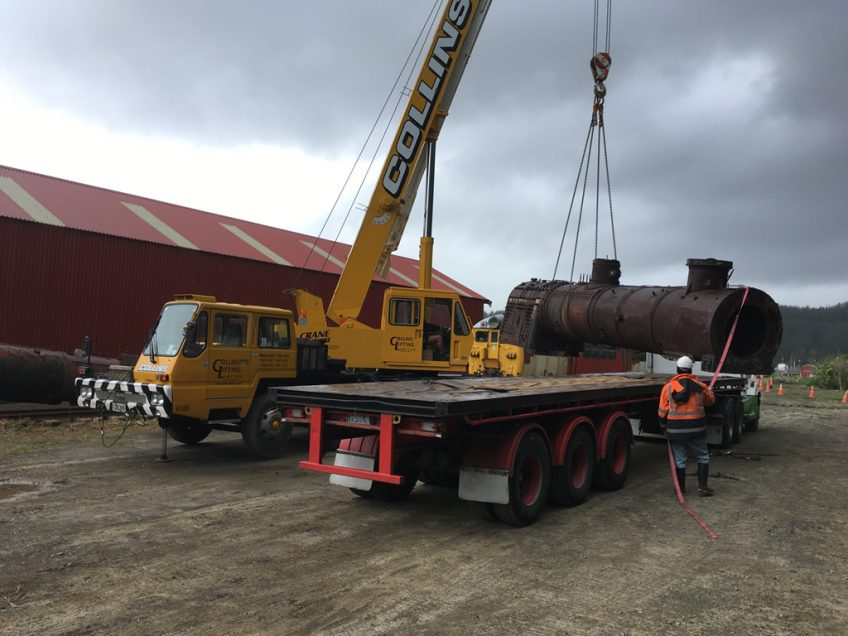 Collins crane unloading replacement boiler from STL Linehaul truck