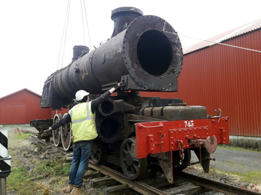Hugh positioning smokebox end of boiler onto the saddle