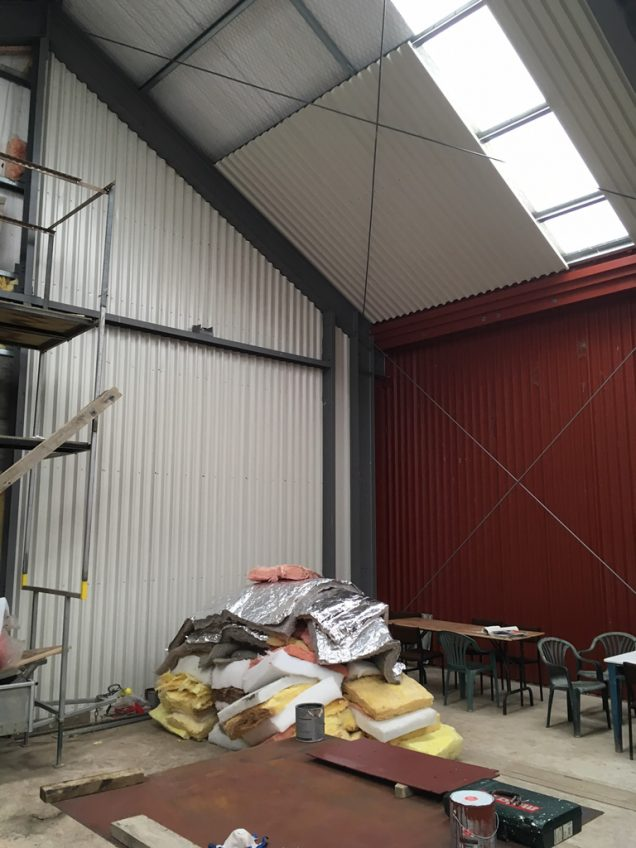 ColorSteel lining on half of an end wall, and ceiling of workshop