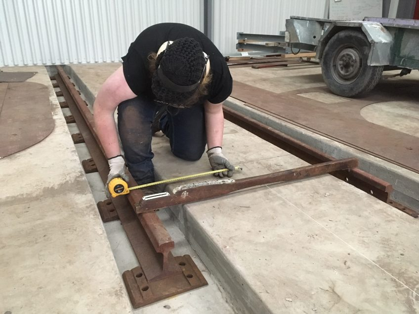 Fitting rails to workshop floor