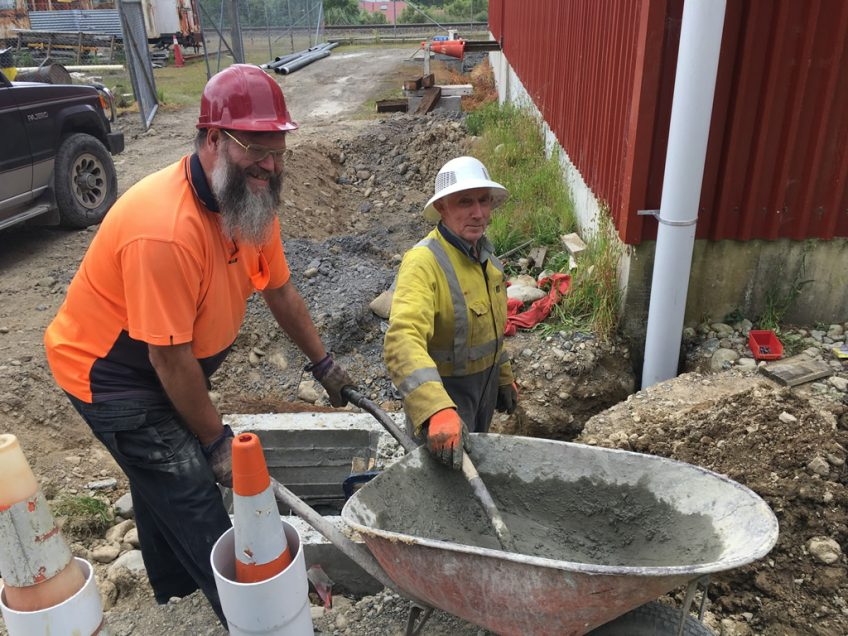 Ray and Bruce working on storm water system for the rail vehicle shed