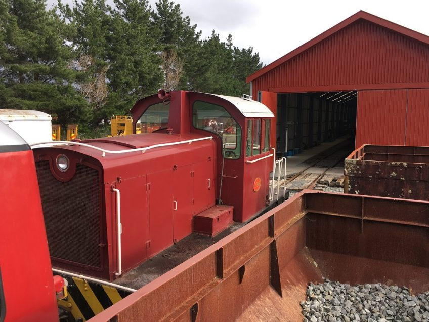 Tr189 with a passenger service stops short of the rail vehicle shed.