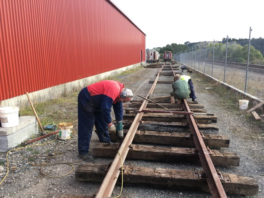 Track work passing the mid-point of the shed