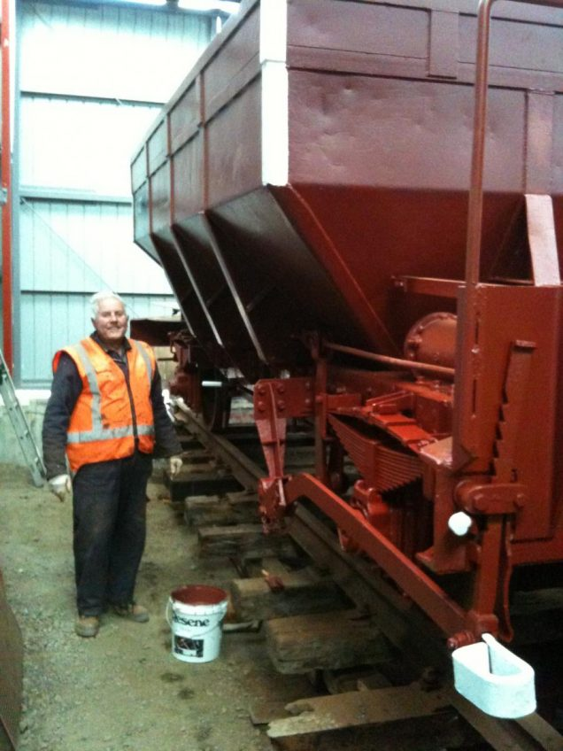 Ron Jones pauses for a photo while painting ballast wagon Yc 817