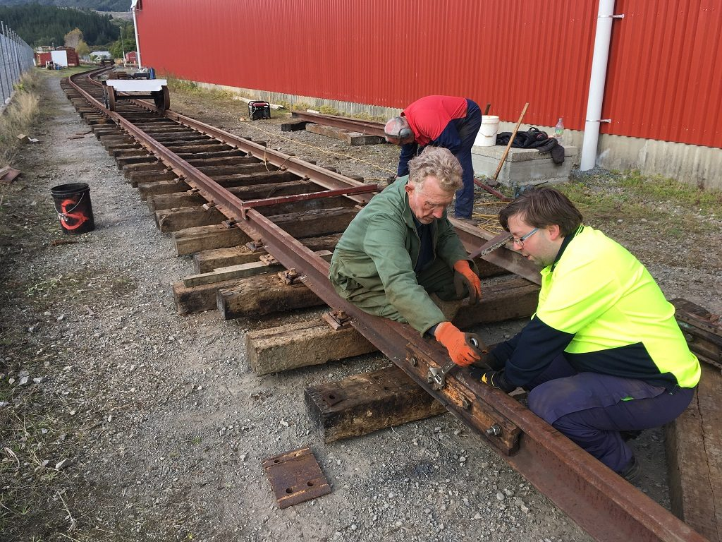 Iain, Bruce and Peter working on turntable road